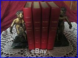Paire de serre livres art déco en régule-chérubins-jeunes éphèbes sur marbre