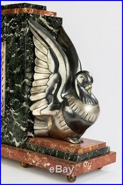 Pendule Art Deco aux pigeons Bronze argentés et marbres