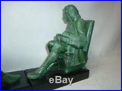 Serre livre signé Max Le verrier en régule art déco sculpture statue art déco